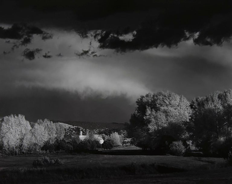 "Ansel Adams (1902-1984).  Autumn Storm, Las Trampas, Near Penasco, New Mexico, 1958. Framed gelatin silver print. Image size 15.5 x 19.55"". Signed on mount recto. Negative date 1958. Print date 1981. Signed on mount recto.  Ansel Adams was an"