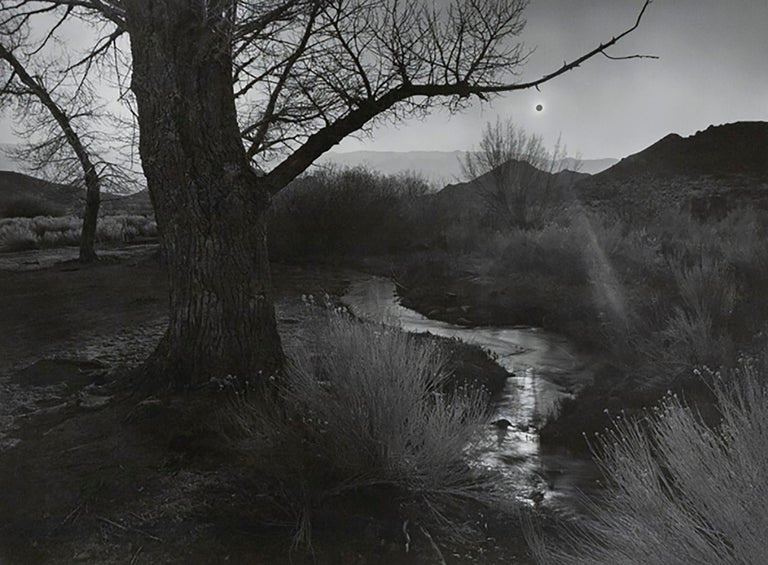 """Ansel Adams (1902-1984).  The Black Sun, Tungsten Hills, Owens Valley, California, 1939. Framed gelatin silver print. Image size 13.5 x 18.25"""". Signed on mount recto. Neg: 1939, print 1974. Signed on mount recto. Edition 52 of 110 from portfolio"""