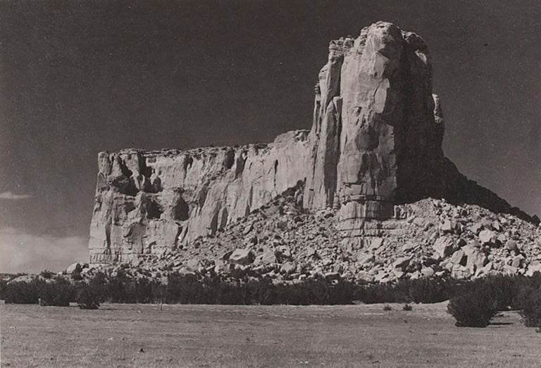 """Ansel Adams (1902-1984). The Enchanted Mesa [Acoma, New Mexico], Ca. 1930. Framed parmelian print. Image size 5.25 x 7.25"""". Signed on mount recto. Negative date 1930. Print date 1930. Signed on mount recto.  Ansel Adams was an American photographer"""
