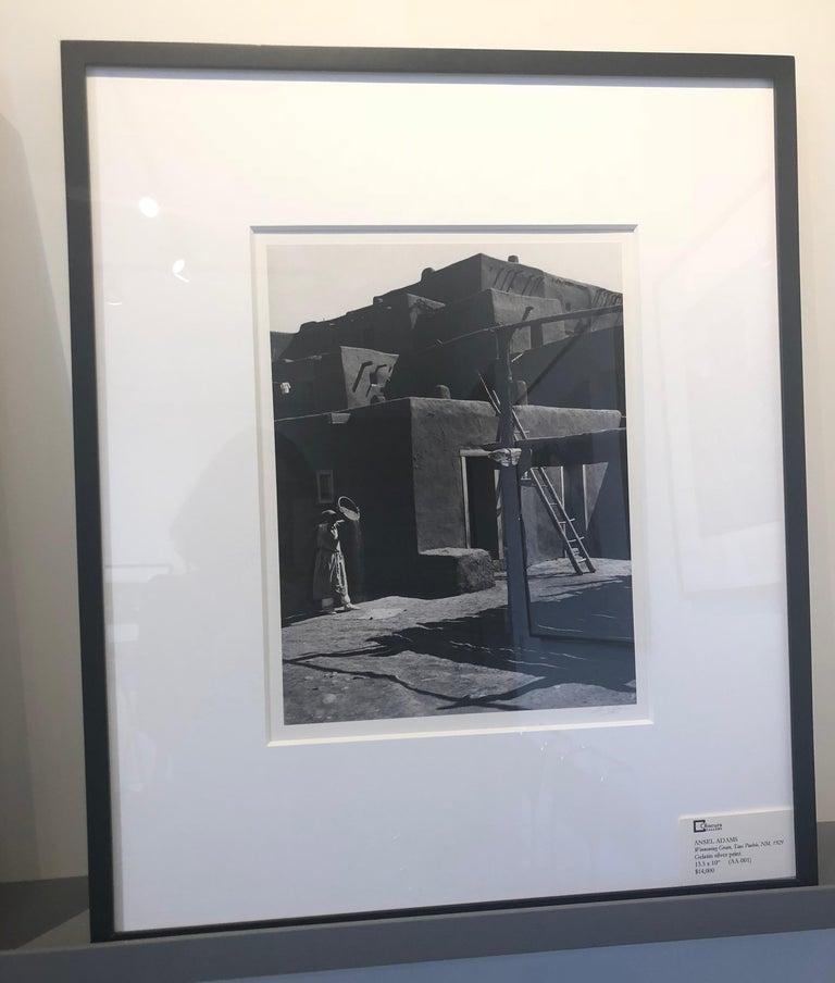 Ansel Adams. Winnowing Grain, Taos, Pueblo, NM, 1929, Silver gelatin print. - Modern Photograph by Ansel Adams