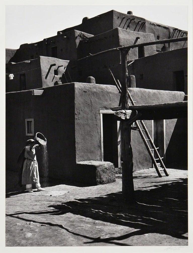Ansel Adams. Winnowing Grain, Taos, Pueblo, NM, 1929, Silver gelatin print. - Photograph by Ansel Adams
