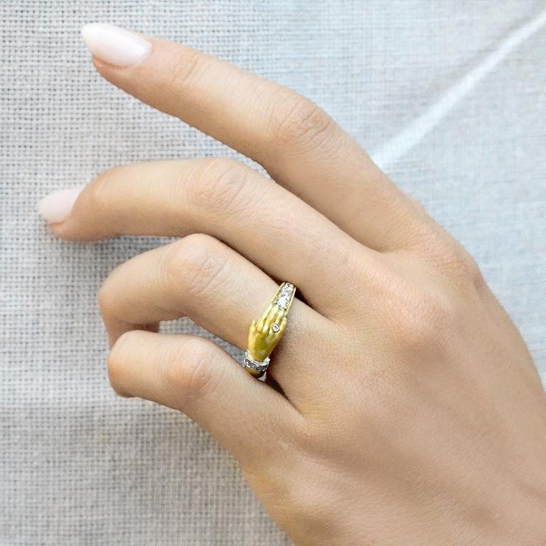 One Hand Band Ring intricately crafted by jewelry maker Anthony Lent in matte and polished 18k yellow gold and platinum featuring a single hand adorned with a gold ring and platinum bracelet, both set with round brilliant-cut white diamonds, and
