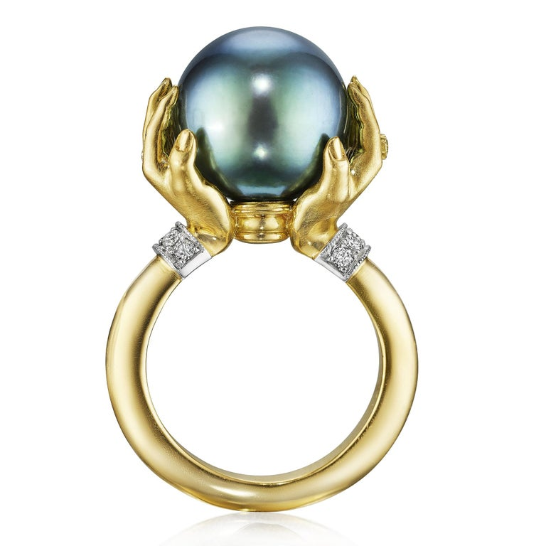 One of a Kind Adorned Hands Ring by jewelry artist Anthony Lent handmade in 18k yellow gold and platinum featuring an exceptional 13mm Tahitian pearl accented with top quality round brilliant-cut white diamond rings and bracelets. Size 6 (can be