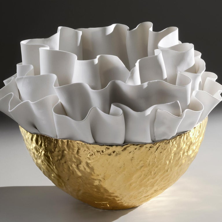 A work of art that is both functional and decorative, this bowl was introduced at Milan Design Week, 2019. It is inspired by sinuous seaweeds with a textured bottom painted in 23-karat gold and a top that showcases the mastery of Fos Ceramiche