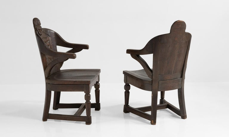 Carved solid oak chairs with male and female faces at the crown.