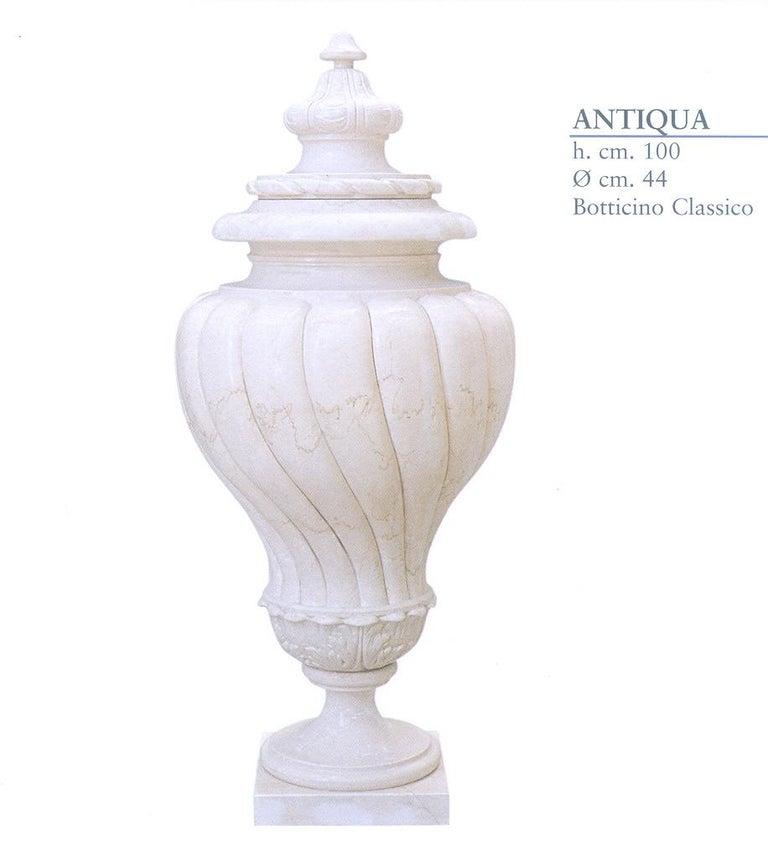 Multi-purpose Antiqua urn in crema marfil marble. Perfect for garden or home decor.