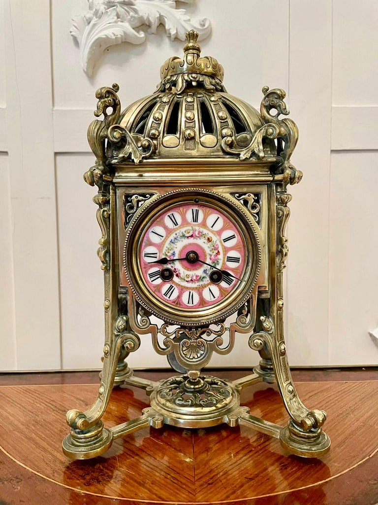 An outstanding antique 19th century French eight day brass gilt metal striking mantel clock by the premier makers of Paris, Henry Marcs and Japy Freres. The pink porcelain dial is an exquisite example depicting a beautiful wreath of pretty flowers