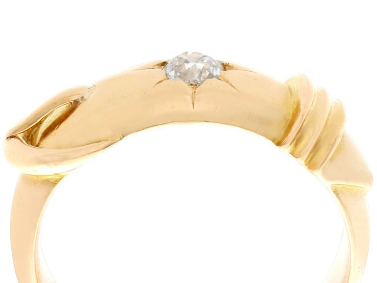 A fine and impressive antique 0.38 carat diamond and 18k yellow gold dress ring in the form of a belt and buckle; part of our diverse antique jewelry and estate jewelry collections.  This fine and impressive diamond buckle ring has been crafted in