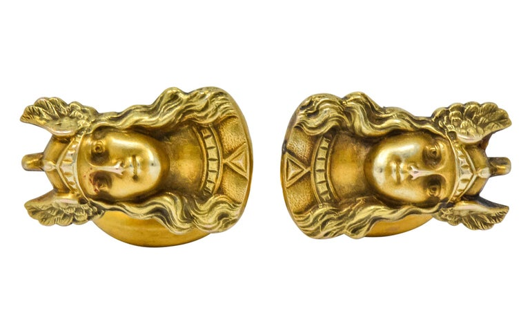 Depicting raised portrait of Norse goddess Valkyrie  With flowing hair and winged helmet  Completed by whale tail back terminating in stationary oval catch  Tested as 10 Karat Gold  Measures: Approx. 5/8 x 3/4 inch  Total weight: 4.9