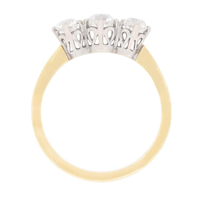 This classic triology rings features a total of 1.00 carat. The diamonds are hand cut, old cut diamonds, dating back to the 1920s. They have been estimated as G in colour and the clarity is VS to SI. Typical of this era, the dazzling diamonds have