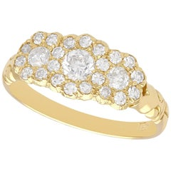Antique 1.01 Carat Diamond and Yellow Gold Trilogy Cluster Ring, Circa 1910