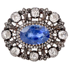 Antique 10.41 Carat Ceylon Natural Sapphire Flor De Lis Halo 18 Karat Brooch Pin
