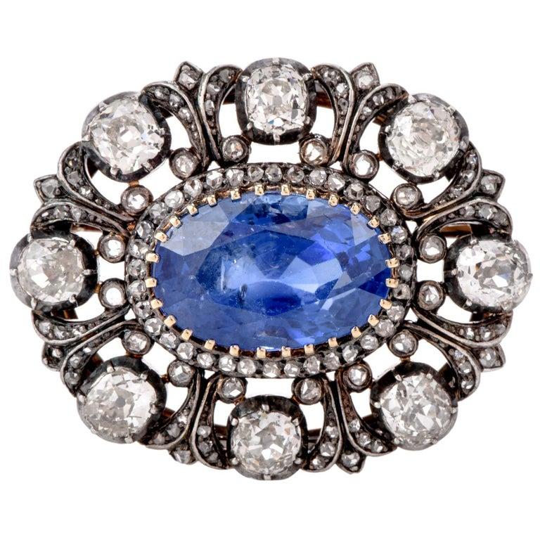Antique 10.41 Carat Ceylon Natural Sapphire Flor De Lis Halo 18 Karat Brooch Pin For Sale