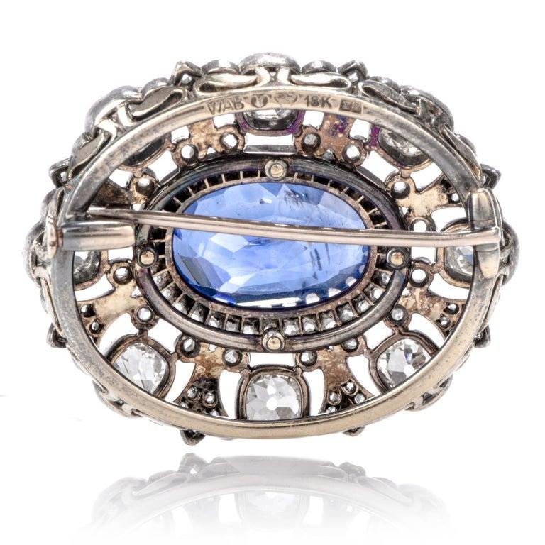 Edwardian Antique 10.41 Carat Ceylon Natural Sapphire Flor De Lis Halo 18 Karat Brooch Pin For Sale