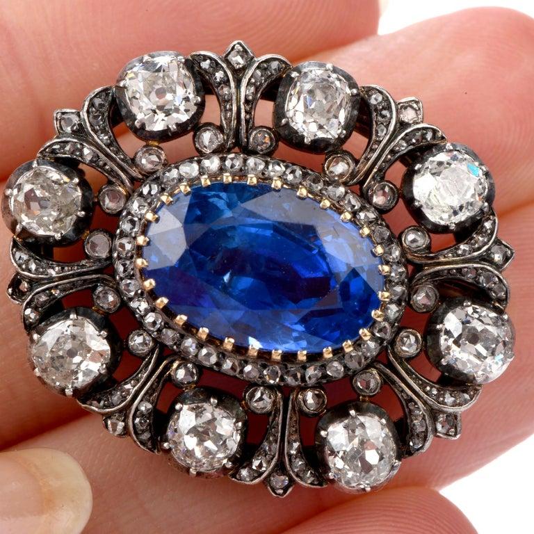 Oval Cut Antique 10.41 Carat Ceylon Natural Sapphire Flor De Lis Halo 18 Karat Brooch Pin For Sale