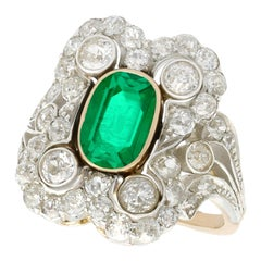 Antique 1.12 Carat Emerald 1.23 Carat Diamond Yellow Gold Cocktail Ring