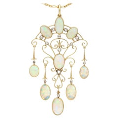 Antique 11.70 Carat Opal and Diamond Yellow Gold Pendant