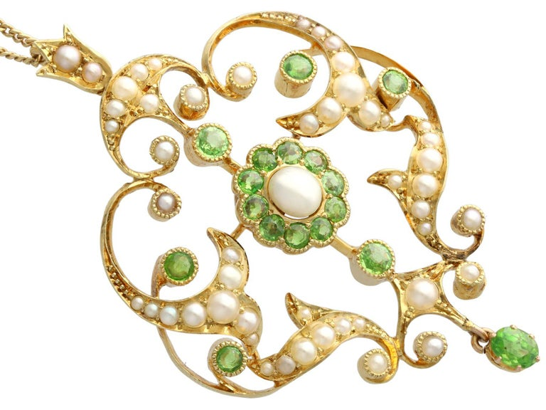 Round Cut Antique 1.19 Carat Demantoid Garnet and Seed Pearl Yellow Gold Pendant Brooch For Sale