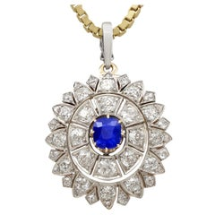 Antique 1.25 Carat Sapphire and 3.43 Carat Diamond Yellow Gold Pendant Brooch