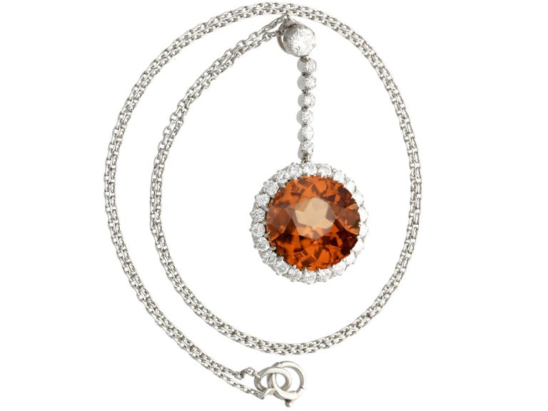 A stunning, fine and impressive antique 12.69 carat zircon and 1.04 carat diamond, palladium necklace with a platinum chain; part of our diverse antique jewelry and estate jewelry collections.  This stunning, fine and impressive antique pendant has