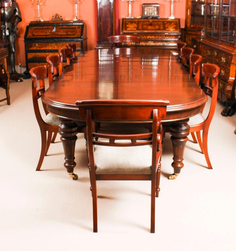 This is a magnificent dining set comprising an antique Victorian solid mahogany D-end dining table, circa 1870 in date, with a set of ten bespoke upholstered back dining chairs.   The beautiful table is in stunning flame mahogany and has four leaves