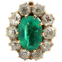 Antique 14 Karat Gold Oval Emerald, Old Mine Cut and Old European Diamond Ring