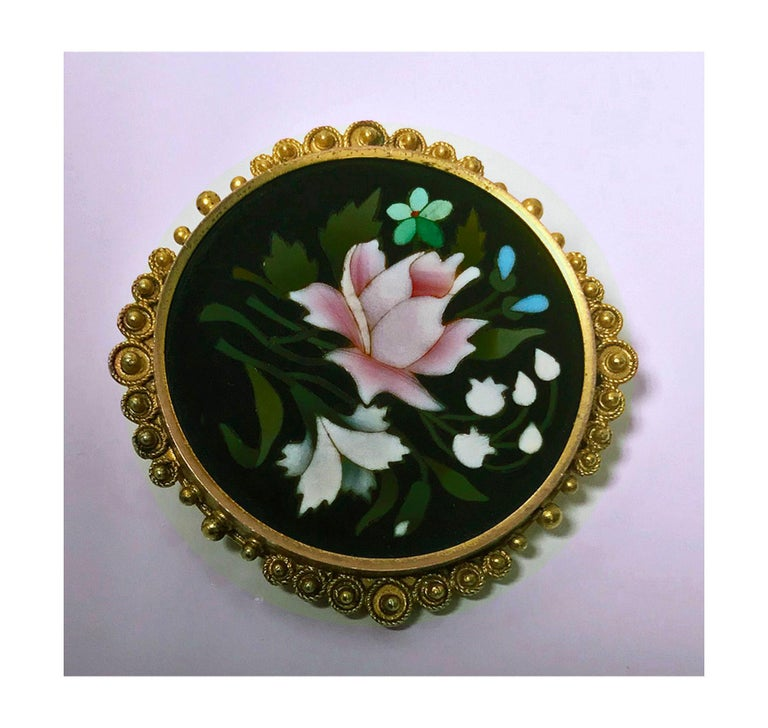 Antique 14K Gold Pietra Dura Brooch Pin, Italy C.1875. The Brooch of circular shape, fine pietra dura floral white, green, lilac inlay colors, the surround gold mount of granular etruscan bead work. Gold acid tests 14K. Diameter: 1.2 inches. Total