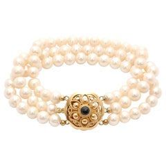 14 Karat Yellow Gold Three-Strand Pearl Bracelet