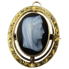 Antique 14 Karat Yellow Gold Sardonyx Cameo Madonna Pin or Pendant, circa 1915
