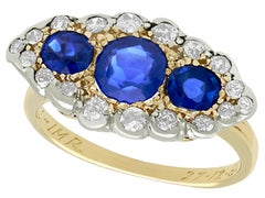 Antique 1.48 Carat Sapphire 1.04 Carat Diamond Yellow Gold Trilogy Cocktail Ring