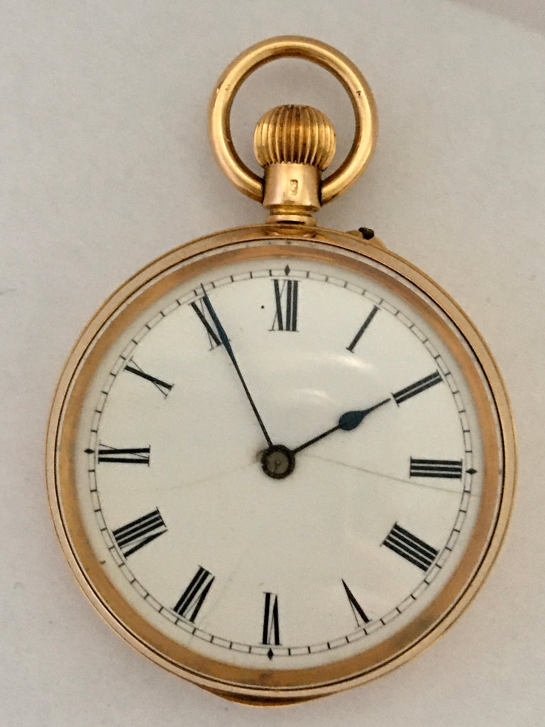 This small gold pocket watch is in good working condition and it is ticking well. Visible hairline cracks on the dial as shown.  Please study the images carefully as form part of the description.
