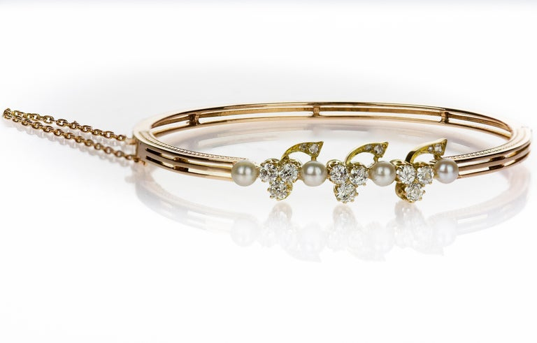 A stunning 15 ct Rose Gold Bangle: triple tiered with fine dotted detailing around the side rim and clasp. In total, there are four sea water pearls, haven't tested could be natural or cultured sea water pearls.  15 Old European cut diamonds,