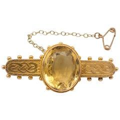 Antique 15 Karat Gold Oval Cut Citrine Brooch Engraved Celtic Knot Detail