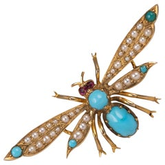 Antique 15 Karat Gold Turquoise Pearl Ruby Winged Insect Brooch, circa 1910