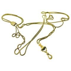 Antique 15 Karat Yellow Gold Long Slide Chain with Hand Motif Lock, 19th Century