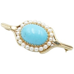 Antique 15.39 Carat Turquoise and Pearl 9 Carat Yellow Gold Brooch