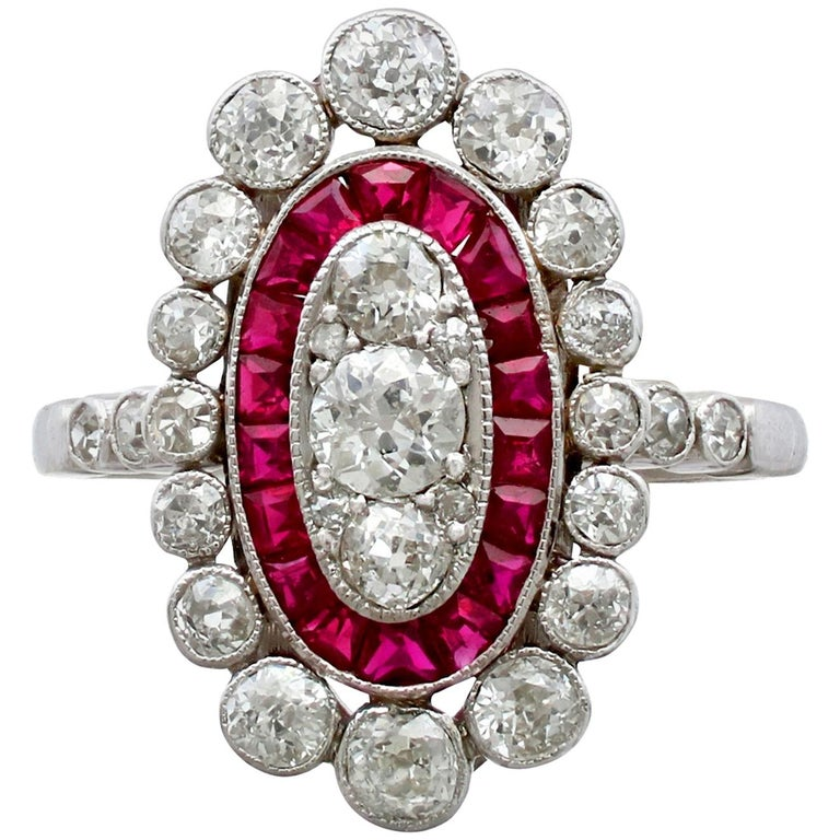 Antique 1.60 Carat Diamond and Ruby Platinum Cluster Ring For Sale