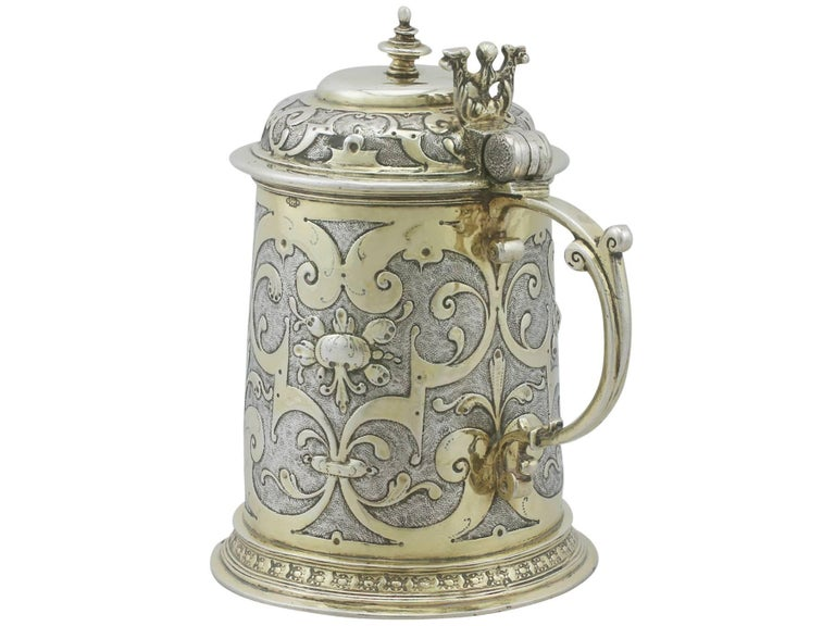 An exceptional, fine and impressive, rare antique German silver quart tankard; an addition to our range of collectable 17th century silverware  This exceptional antique German silver tankard has a plain tapering cylindrical form onto a circular