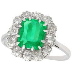 Antique 1.62 Carat Emerald Diamond Platinum Cluster Ring