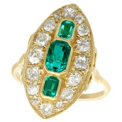 Antique 1.76 Carat Emerald 2.05 Carat Diamond Yellow Gold Marquise Ring