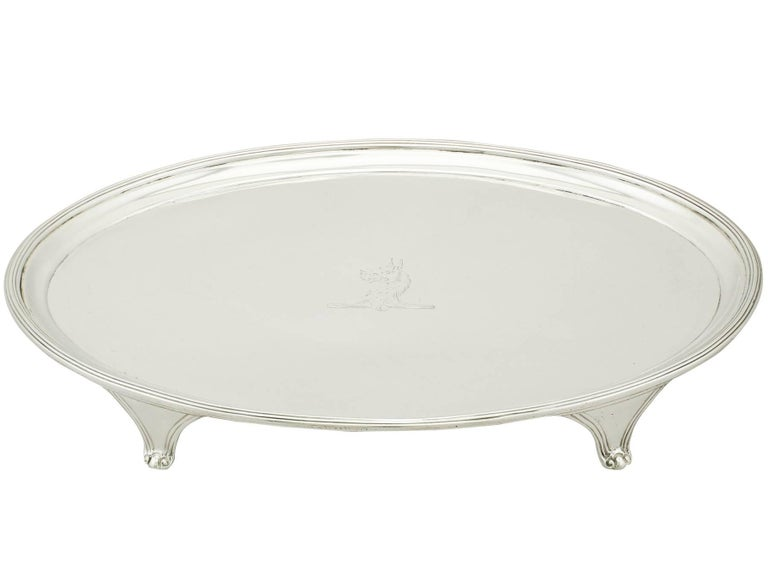 An exceptional, fine and impressive antique George III English sterling silver salver made by Henry Chawner; an addition to our Georgian silverware collection  This exceptional antique George III sterling silver salver by Henry Chawner has a plain