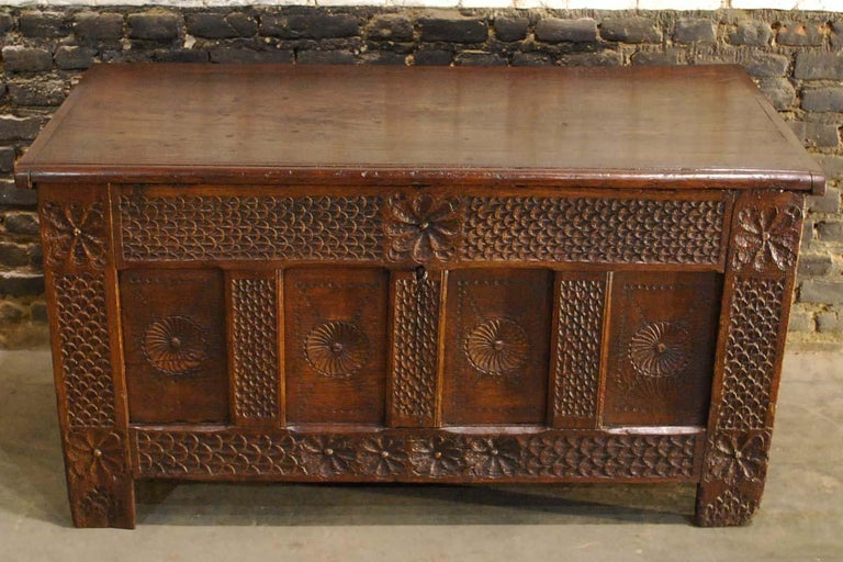 This solid oak carved chest was made in the Netherlands during the Renaissance period. 