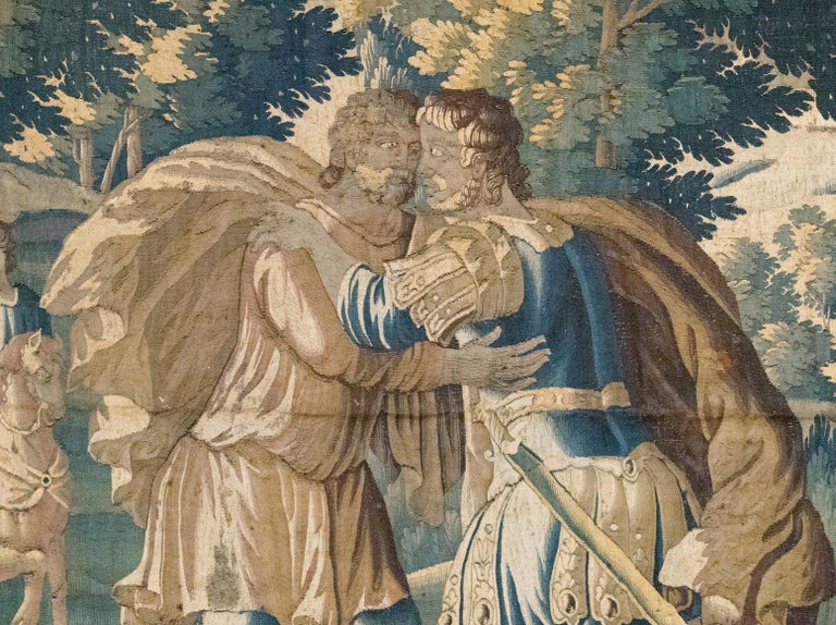 This is a gorgeous antique 17th century Flemish Verdure Tapestry depicting the Reconciliation of Jacob and Esau. The tapestry illustrates the Old Testament story of Jacob making peace with his twin brother Esau, many years after he had robbed Esau