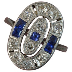 Antique 18 Carat White Gold Sapphire and Diamond Panel Cluster Ring