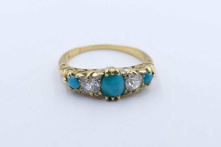 This lovely old Victorian/Edwardian Ring is comprised of 3 good mid-blue Turquoise stones with the addition of 2 old cut Diamonds & 4 smaller rose cut Diamonds.  One Turquoise measures 6.0 X 4.5mm with the remaining 2 measuring 2.5mm. The 2 Diamonds