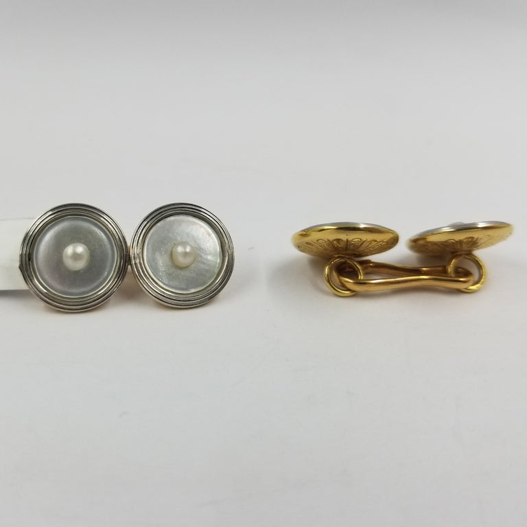 Set of 2 vintage cufflinks crafted in 18 karat white & yellow gold (stamped), mother of pearl, and cultured pearls. The fronts are all white gold with a ridged exterior, and concave mother of pearl centers. The backs are a textured yellow gold with