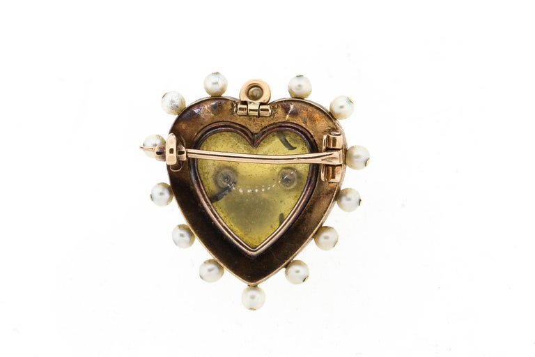 A bright antique 18k gold green and white enamel heart pin/pendant set with rosecut diamonds and pearls. The front of the pin has two pearls surrounded by diamonds in a double heart shape. Such a classic sentimental Victorian design. The green