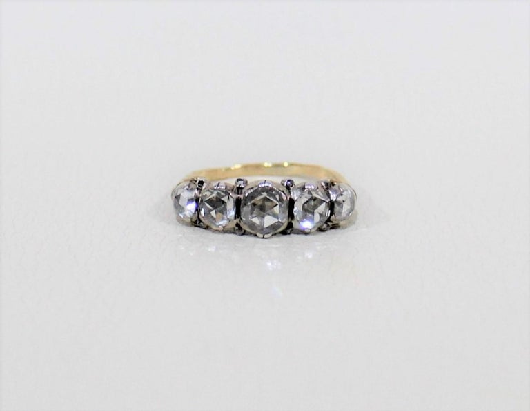 Ladies 18-carat yellow and white gold hand assembled antique ring with a bright polished finish.  Specifications:  Ring size: 6.25 Total weight of diamonds: .80 carat Total weight of ring: 3.50 grams  One claw set rose cut diamond, measuring