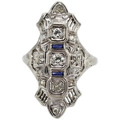 Antique 18 Karat White Gold Diamond and Sapphire Navette Cocktail Ring