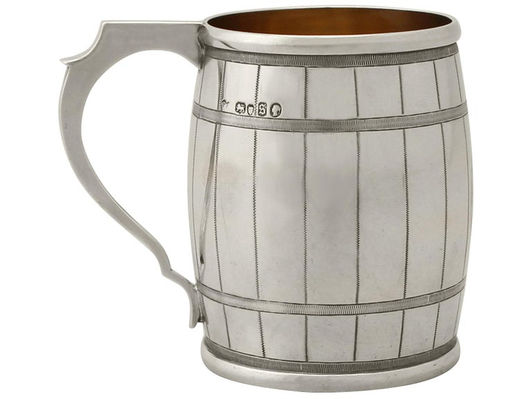 An exceptional, fine and impressive antique Victorian English sterling silver christening mug in the form of a barrel, made by George Adams; an addition to our silver christening gifts collection  This exceptional antique Victorian sterling silver